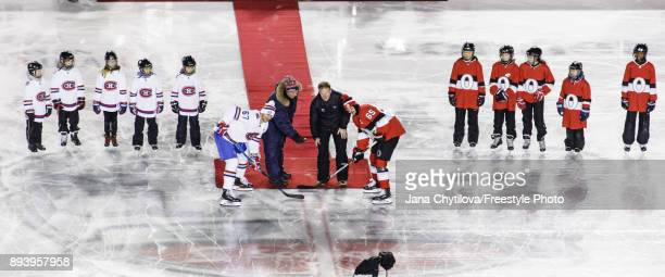 Max Pacioretty of the Montreal Canadiens and Erik Karlsson of the Ottawa Senators line up for the ceremonial puck drop between former Montreal...