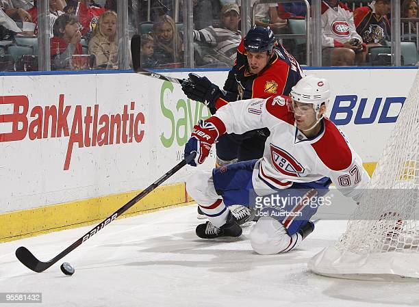 Max Pacioretty of the Montreal Canadiens and Stephen Weiss of the Florida Panthers skate after the puck on December 31 2009 at the BankAtlantic...