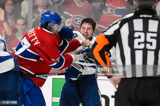 Max Pacioretty of the Montreal Canadiens and Tyler Johnson of the Tampa Bay Lightning clash in Game Five of the Eastern Conference Semifinals during...