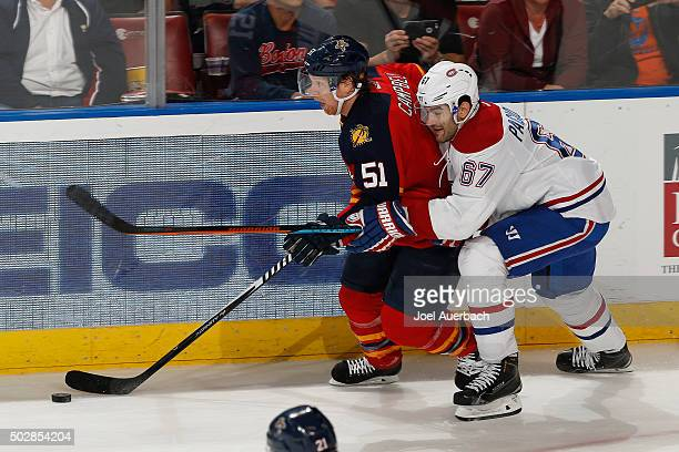 Max Pacioretty of the Montreal Canadiens attempts to take the puck from Brian Campbell of the Florida Panthers at the BBT Center on December 29 2015...