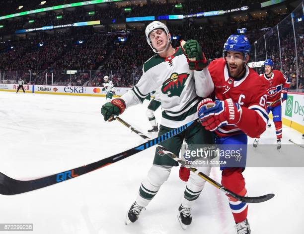 Max Pacioretty of the Montreal Canadiens battles for position against Mike Reilly of the Minnesota Wild in the NHL game at the Bell Centre on...