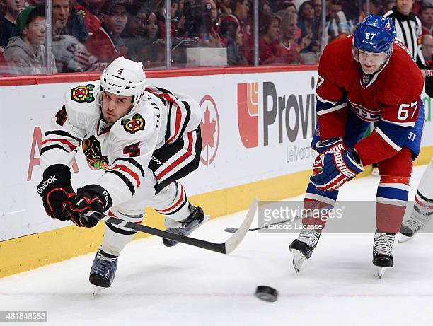 Max Pacioretty of the Montreal Canadiens breaks his stick while challenging Niklas Hjalmarsson of the Chicago Blackhawks during the NHL game on...