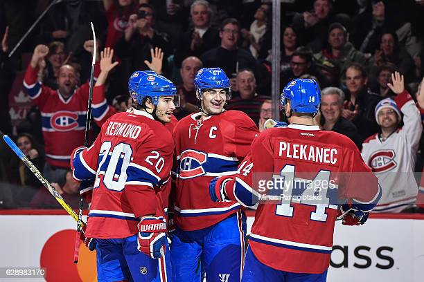 Max Pacioretty of the Montreal Canadiens celebrates his hattrick goal in the second period with teammates during the NHL game against the Colorado...