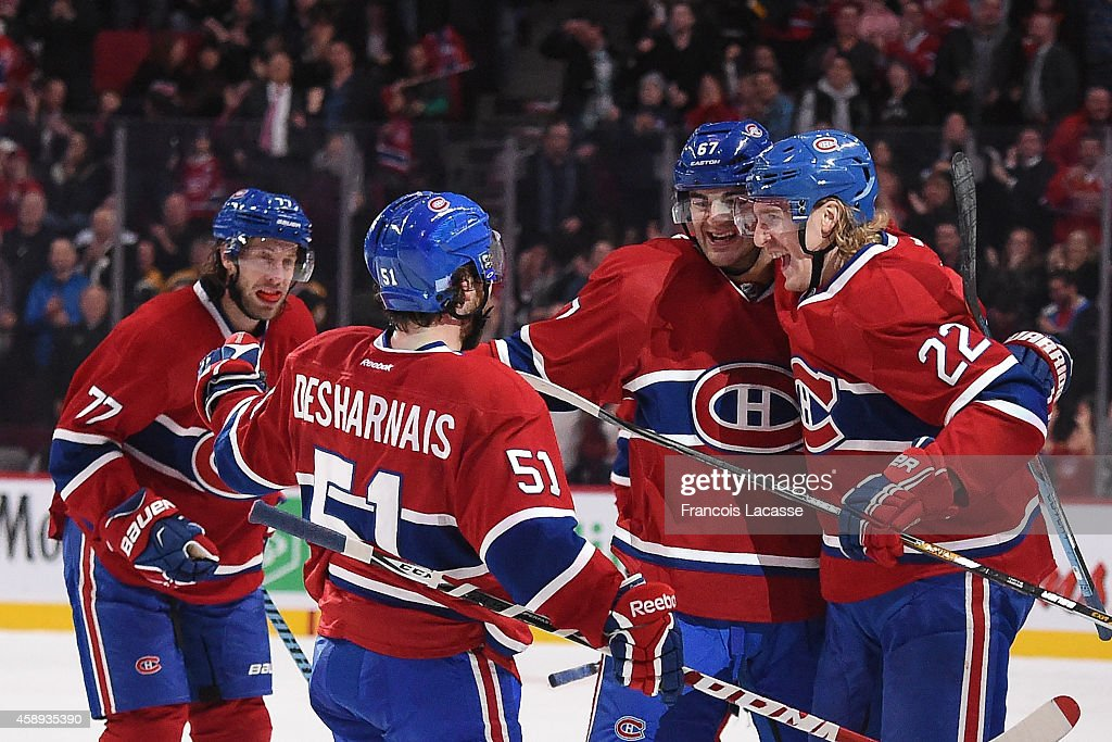 Max Pacioretty #67 of the Montreal Canadiens celebrates with Dale Weise #22, David Desharnais #51 and Tom Gilbert #77 after scoring a goal against the Boston Bruins in the NHL game at the Bell Centre on November 13, 2014 in Montreal, Quebec, Canada.