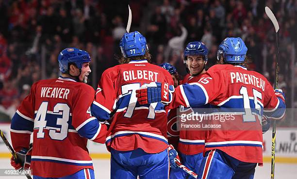 Max Pacioretty of the Montreal Canadiens celebrates with teammates after scoring a goal against of the St Louis Blues in the NHL game at the Bell...