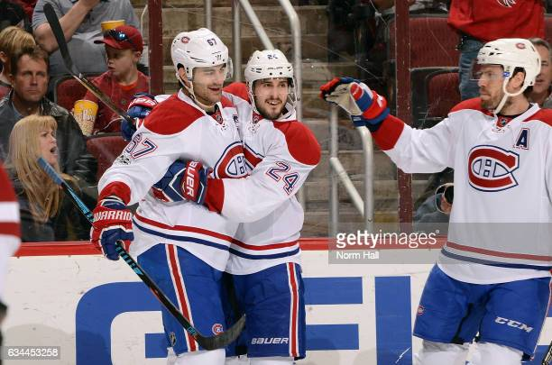 Max Pacioretty of the Montreal Canadiens celebrates with teammates Phillip Danault and Shea Weber after scoring a first peirod goal against the...