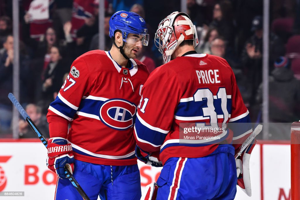 Max Pacioretty #67 of the Montreal Canadiens congratulates goaltender Carey Price #31 for their victory against the Detroit Red Wings during the NHL game at the Bell Centre on December 2, 2017 in Montreal, Quebec, Canada. The Montreal Canadiens defeated the Detroit Red Wings 10-1.