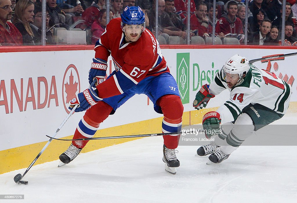 Max Pacioretty #67 of the Montreal Canadiens controls the puck while being challenged by Justin Fontaine #14 of the Minnesota Wild during the NHL game on November 19, 2013 at the Bell Centre in Montreal, Quebec, Canada.