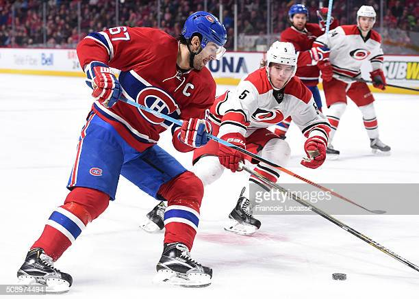 Max Pacioretty of the Montreal Canadiens controls the puck while being challenged by Noah Hanifin of the Carolina Hurricanes in the NHL game at the...