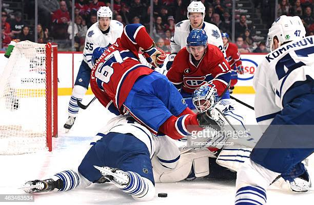 Max Pacioretty of the Montreal Canadiens falls on goalie Jonathan Bernier of the Toronto Maple Leafs in the NHL game at the Bell Centre on February...