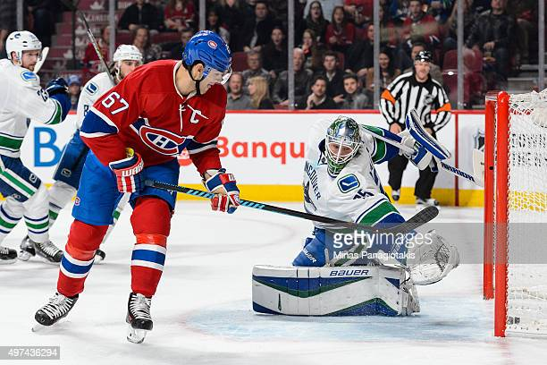 Max Pacioretty of the Montreal Canadiens gets the puck past goaltender Jacob Markstrom of the Vancouver Canucks and scores during the NHL game at the...