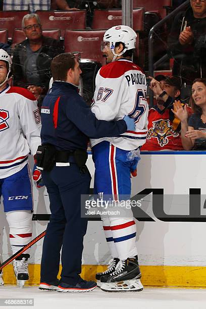 Max Pacioretty of the Montreal Canadiens is assisted off the ice by a team trainer after being injured during firstperiod action against the Florida...
