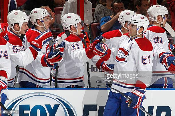 Max Pacioretty of the Montreal Canadiens is congratulated by teammates after scoring a first period goal against the Florida Panthers at the BBT...