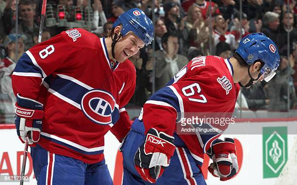 Max Pacioretty of the Montreal Canadiens is congratulated for his goal against the Toronto Maple Leafs by teammate Mike Komisarek at the Bell Centre...