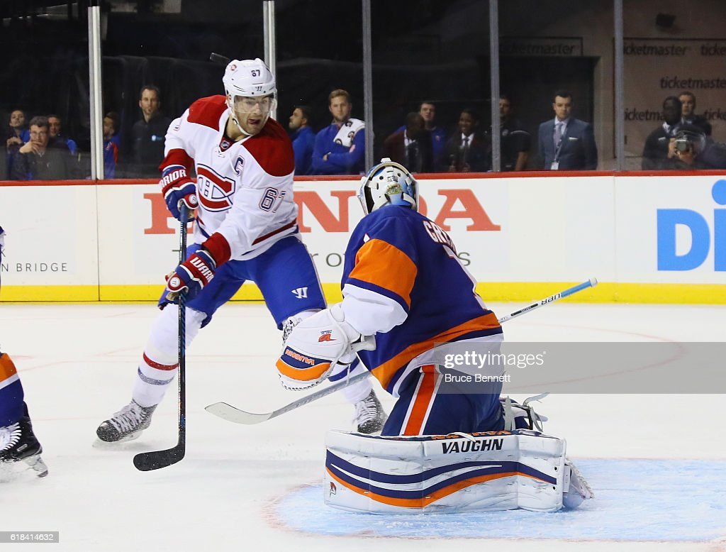 Max Pacioretty #67 of the Montreal Canadiens looks for a first period rebound from Thomas Greiss #1 of the New York Islanders at the Barclays Center on October 26, 2016 in the Brooklyn borough of New York City.