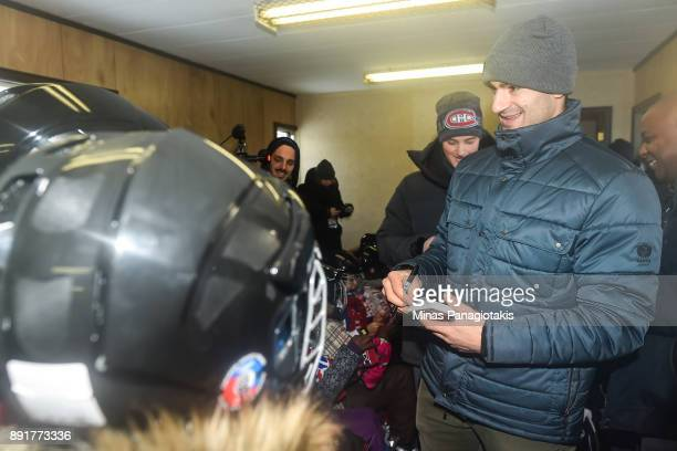 Max Pacioretty of the Montreal Canadiens meets and signs autographs for children during the official inauguration of the Bleu Blanc Bouge rink by the...