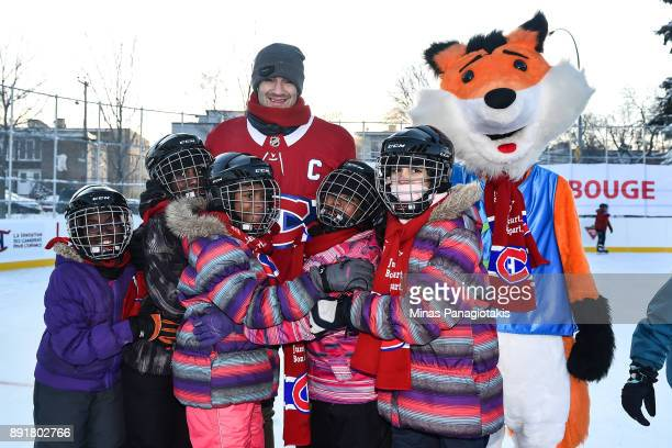 Max Pacioretty of the Montreal Canadiens poses with a group of children during the official inauguration of the Bleu Blanc Bouge rink by the Montreal...