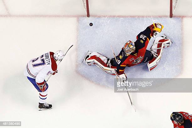Max Pacioretty of the Montreal Canadiens scores a goal against goaltender Dan Ellis of the Florida Panthers in the second period at the BBT Center on...