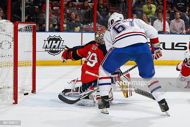 Max Pacioretty of the Montreal Canadiens scores a second period goal past goaltender Dan Ellis of the Florida Panthers at the BBT Center on March 29...