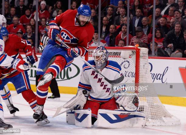 Max Pacioretty of the Montreal Canadiens screens Henrik Lundqvist of the New York Rangers during Game Five of the Eastern Conference Final in the...