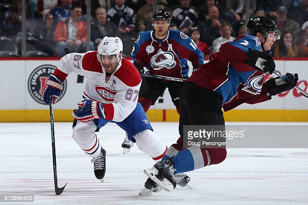 Max Pacioretty of the Montreal Canadiens skates against Nick Holden of the Colorado Avalanche at Pepsi Center on February 17 2016 in Denver Colorado...