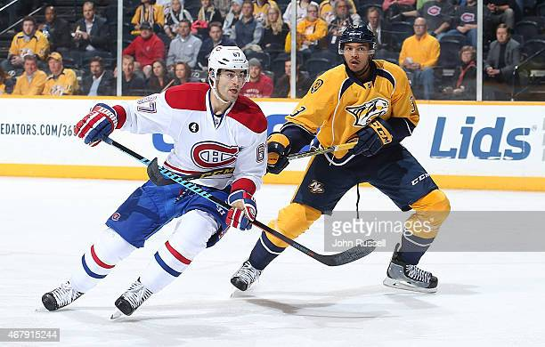 Max Pacioretty of the Montreal Canadiens skates against Seth Jones of the Nashville Predators during an NHL game at Bridgestone Arena on March 24...