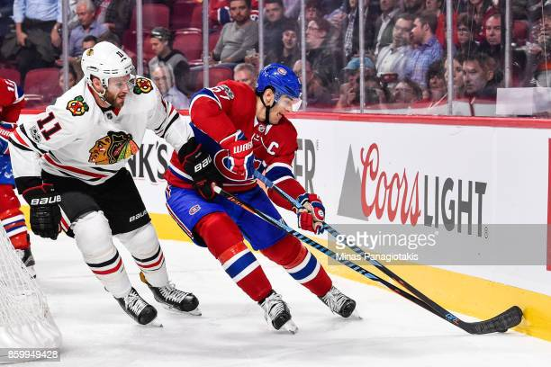 Max Pacioretty of the Montreal Canadiens skates the puck against Cody Franson of the Chicago Blackhawks during the NHL game at the Bell Centre on...