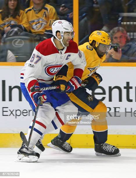 Max Pacioretty of the Montreal Canadiens ties up the stick of PK Subban of the Nashville Predators during the second period at Bridgestone Arena on...
