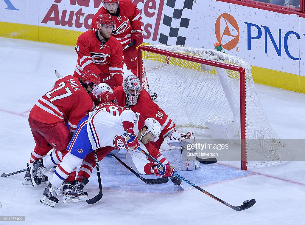 Max Pacioretty #67 of the Montreal Canadiens works to score against Justin Faulk #27, Teuvo Teravainen #86 and Cam Ward #30 of the Carolina Hurricanes during the game at PNC Arena on November 18, 2016 in Raleigh, North Carolina. The Hurricanes won 3-2.