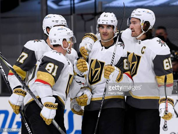 Max Pacioretty of the Vegas Golden Knights celebrates his goal with Mark Stone, Jonathan Marchessault and Shea Theodore, to take a 4-2 lead over the...