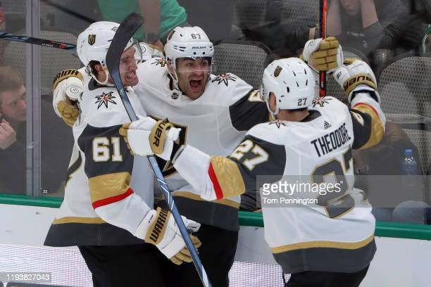 Max Pacioretty of the Vegas Golden Knights celebrates with Mark Stone of the Vegas Golden Knights and Shea Theodore of the Vegas Golden Knights after...