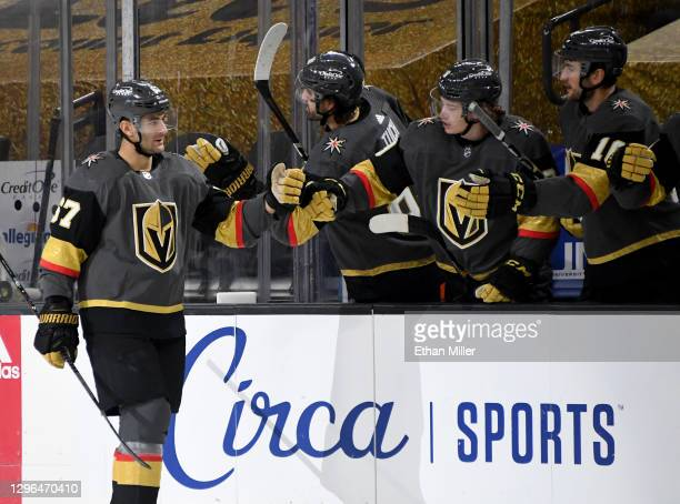 Max Pacioretty of the Vegas Golden Knights celebrates with teammates on the bench after scoring a third-period goal against the Anaheim Ducks during...