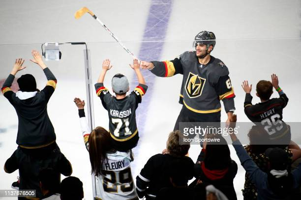 Max Pacioretty of the Vegas Golden Knights gives his stick to a young fan after winning Game Four of the Western Conference First Round of the 2019...
