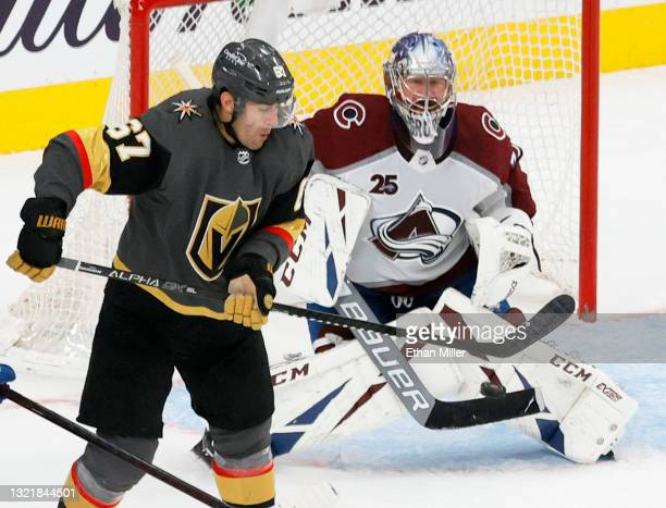 Max Pacioretty of the Vegas Golden Knights redirects a slap shot past Philipp Grubauer of the Colorado Avalanche for a goal in the third period in...