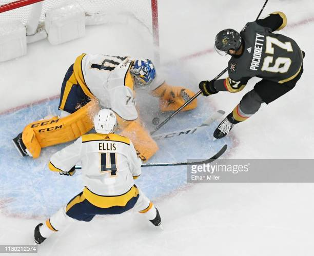 Max Pacioretty of the Vegas Golden Knights scores a firstperiod goal against Juuse Saros of the Nashville Predators as Ryan Ellis of the Predators...