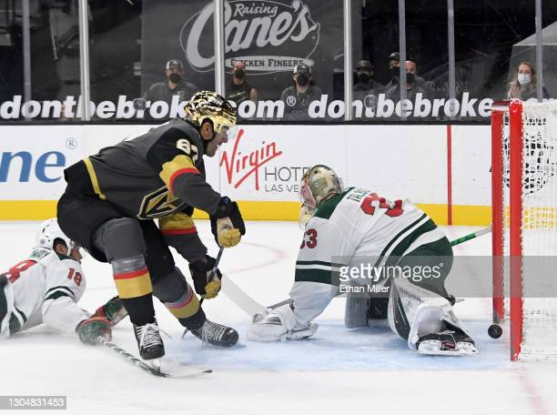 Max Pacioretty of the Vegas Golden Knights scores a goal in overtime against Cam Talbot of the Minnesota Wild to win the game 5-4 at T-Mobile Arena...