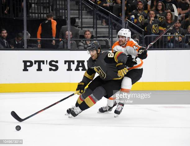 Max Pacioretty of the Vegas Golden Knights skates with the puck under pressure from Andrew MacDonald of the Philadelphia Flyers in the second period...