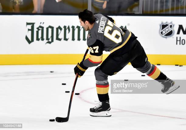 Jonathan Marchessault of the Vegas Golden Knights gives his stick to a young fan after being named one of the stars of the game during a preseason...