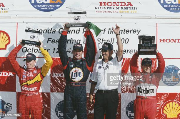 Max Papis of Italy driver of the Team Rahal Lola B01/00 Ford XF V8t celebrates alongside team owner Bobby Rahal second placed Memo Gidley and third...
