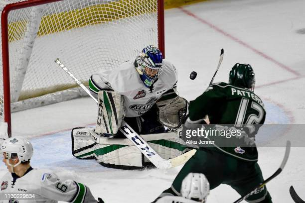 Max Patterson of the Everett Silvertips shoots on Roddy Ross of the Seattle Thunderbirds at accesso ShoWare Center on February 16 2019 in Kent...