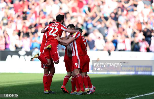 Max Power of Sunderland and celebrates with team mates after putting his team 10 up during the Sky Bet League 1 match between Peterborough and...