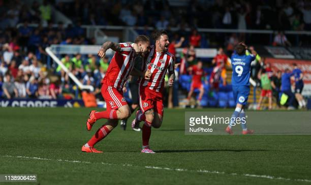 Max Power of Sunderland celebrates with Chris Maguire after putting his team 10 up during the Sky Bet League 1 match between Peterborough and...