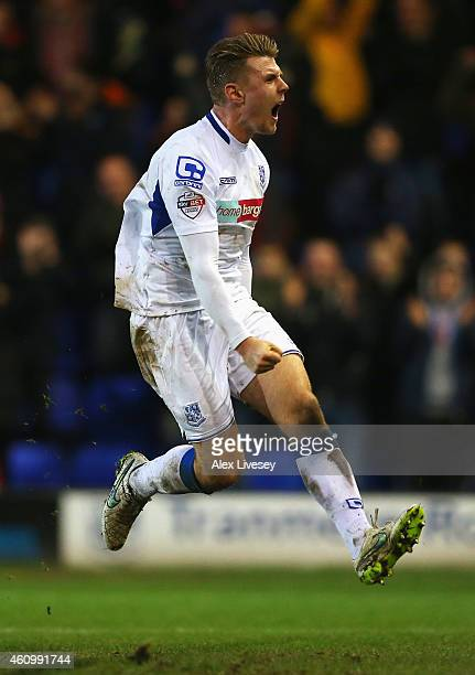 Max Power of Tranmere celebrates scoring his goal during the FA Cup Third Round match between Tranmere Rovers and Swansea City at Prenton Park on...