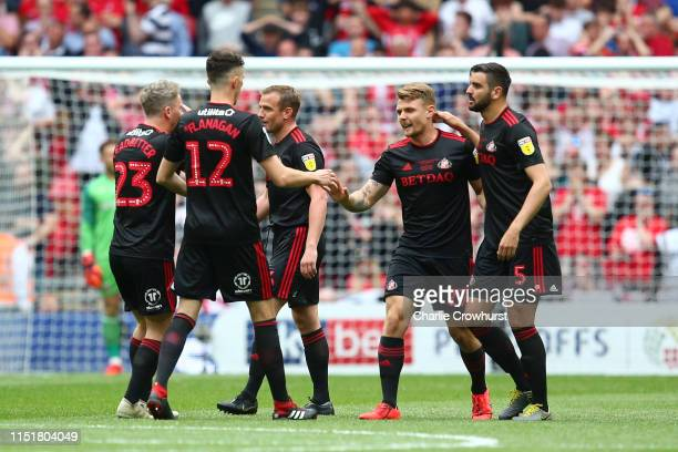 Max Power Tom Flanagan and Alim Ozturk of Sunderland celebrates after Naby Sarr of Charlton Athletic scored an own goal during the Sky Bet League One...