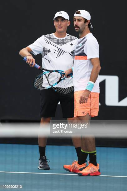 Max Purcell and Jordan Thompson of Australia talk tactics in their Men's Doubles 1st round match against Nikoloz Basilashvili of Georgia and Andrew...