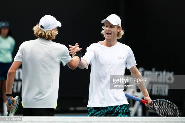 Max Purcell and Luke Saville of Australia celebrate after winning a point their Men's Doubles first round match against Andrey Rublev of Russia and...