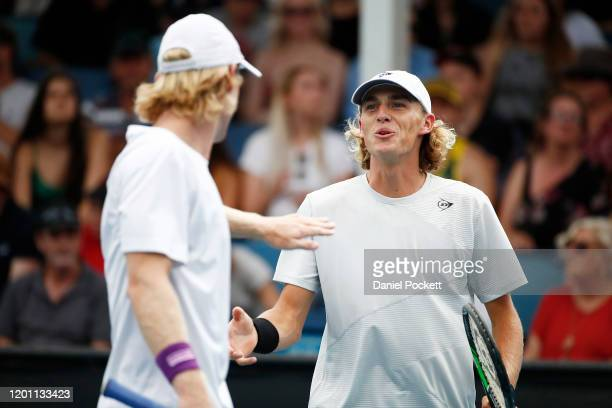 Max Purcell and Luke Saville of Australia celebrate after winning a point during their Men's Doubles first round match against Andrey Rublev of...
