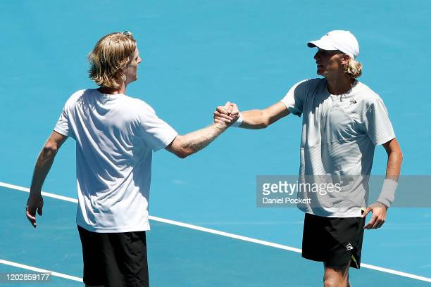 Max Purcell and Luke Saville of Australia celebrate after winning match point in their Men's Doubles Semifinals match against Ivan Dodig of Croatia...