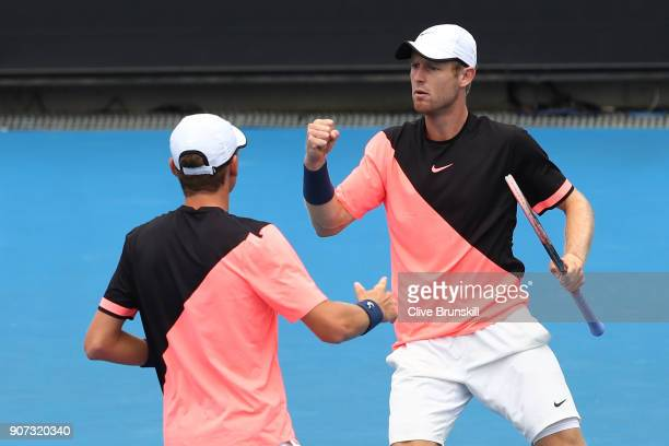 Max Purcell and Luke Saville of Australia celebrate winning a point in their second round men's doubles match against Lukasz Kubot of Poland and...