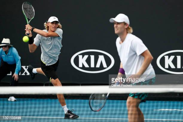 Max Purcell and Luke Saville of Australia play in their Men's Doubles first round match against Andrey Rublev of Russia and Andrei Vasilevski of...